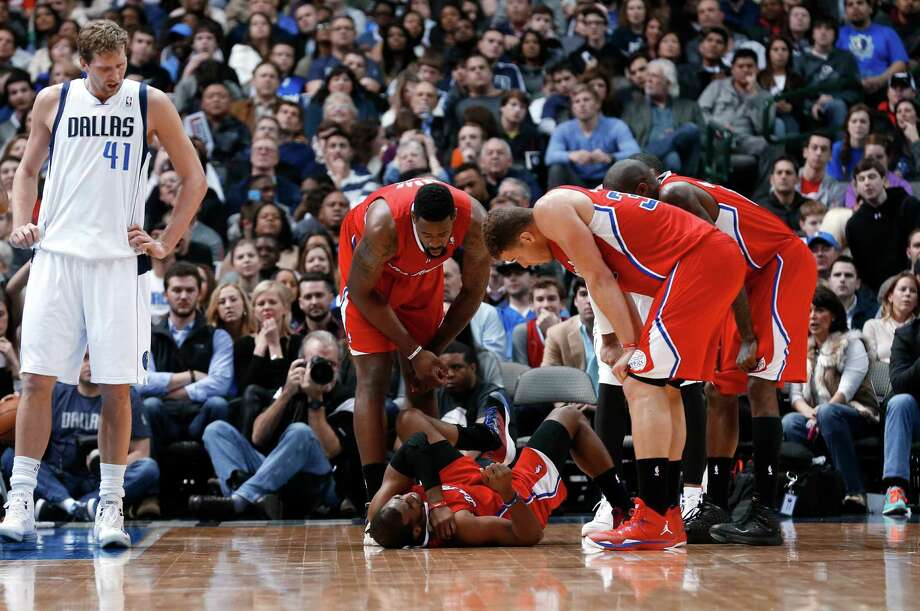 The Clippers found out that guard Chris Paul, holding his injured shoulder on Friday night, will miss six weeks but won't need surgery. Photo: Sharon Ellman, FRE / FR170032 AP