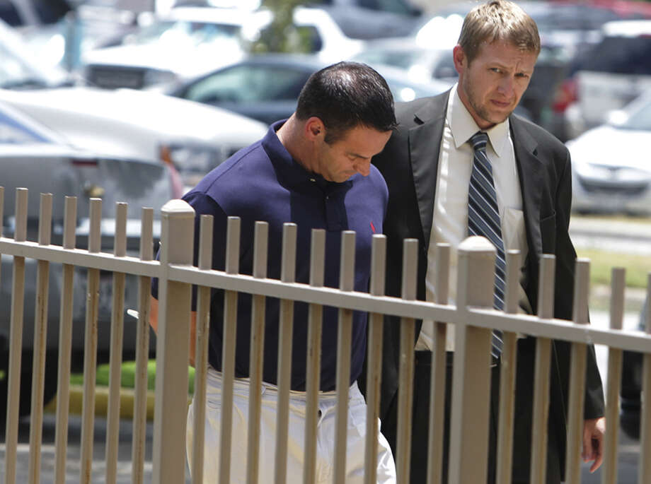 Lawrence Peter Fenti (left) is expected to formally plead guilty this week to conspiracy to commit wire fraud, as is another Army retiree who worked with him at BAMC. Photo: San Antonio Express-News File Photo / © San Antonio Express-News