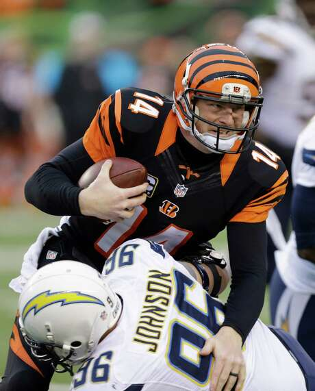 The anatomy of a tough day for Bengals quarterback Andy Dalton (14): two interceptions, one lost fumble and three sacks, including one by Chargers linebacker Jarret Johnson. Photo: Al Behrman, STF / AP