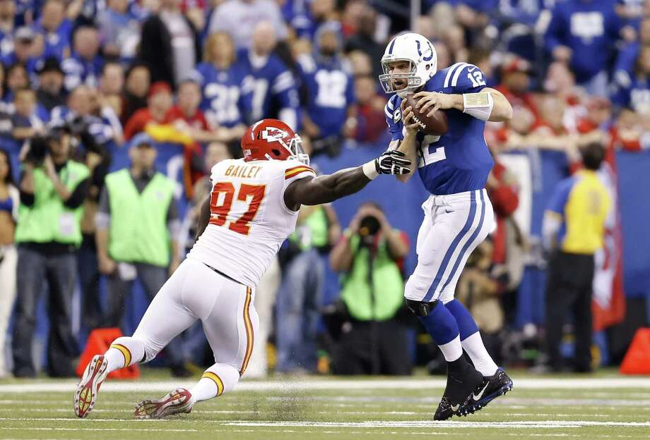 Colts quarterback Andrew Luck, right, evaded Chiefs defensive end Allen Bailey while overcoming an even bigger obstacle - a 28-point deficit - on Saturday. Photo: Sam Riche / MCT