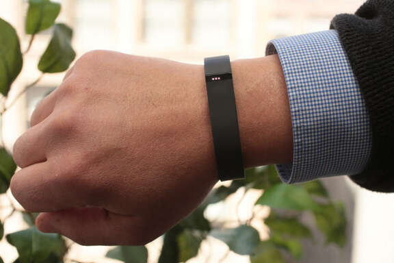 The Fitbit Flex is a wristband that tracks steps, distance, active minutes, and calories burned. Lights on the device track the wearer's progress toward a goal. It tracks sleep quality and wakes its wearer up with a silent, vibrating alarm in the morning.