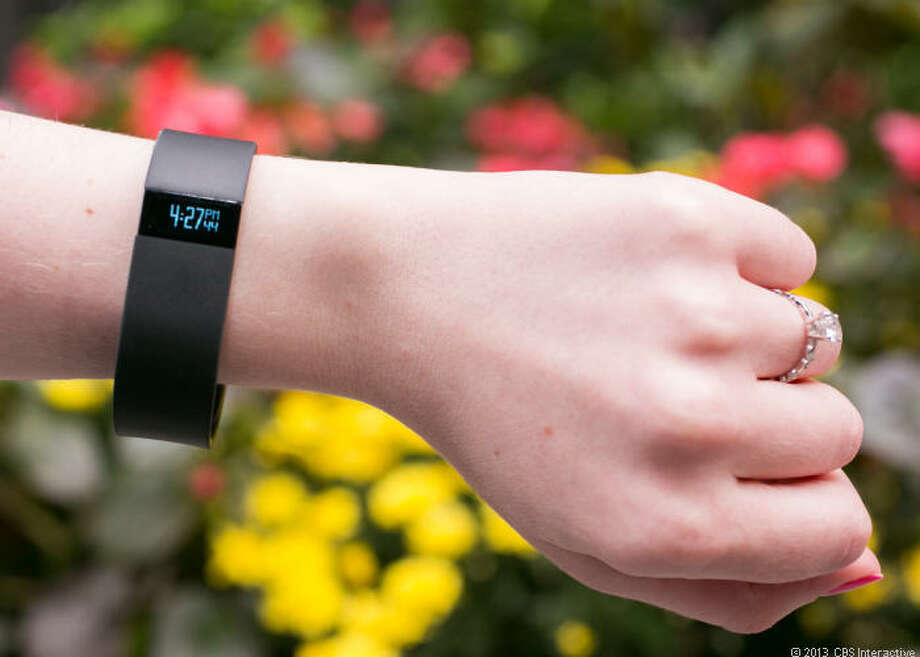 The Fitbit Force tracks distance, steps, calories burned, stairs climbed, and active minutes. At night, it offers the same quality-of-sleep tracker and silent alarm as the Flex. The Force also tells time. Photo: Cnet / ONLINE_YES