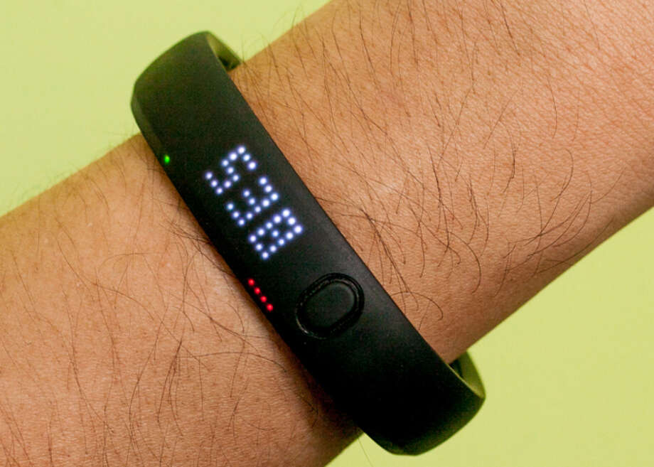 The Nike+ Fuelband tracks steps, calories burned, and NikeFuel. It can sync through Bluetooth to iPhone 4S and above and iPod Touch 5th generation and above. Fuelband users can connect with each other through Nike+ Groups. The device also tells time. Photo: Cnet