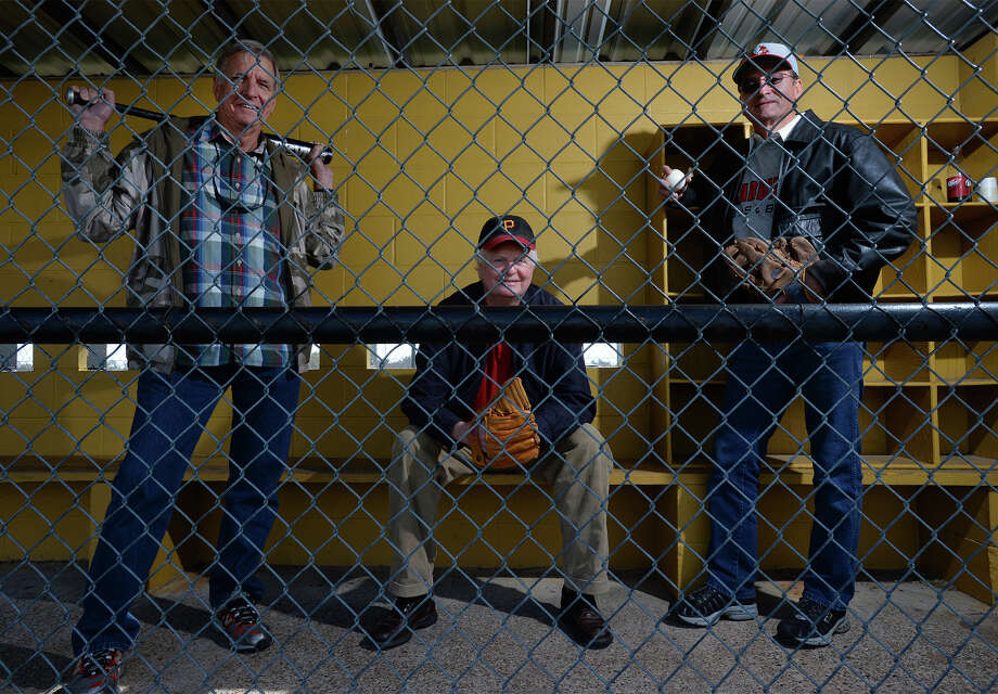 From left, Johnny McInnis, Lynn Hawkins and Mike Guillot played little league baseball as children. The trio stands at the Nederland Little League field on Thursday. Photo taken Thursday, December 12, 2013 Guiseppe Barranco/@spotnewsshooter Photo: Guiseppe Barranco, Photo Editor
