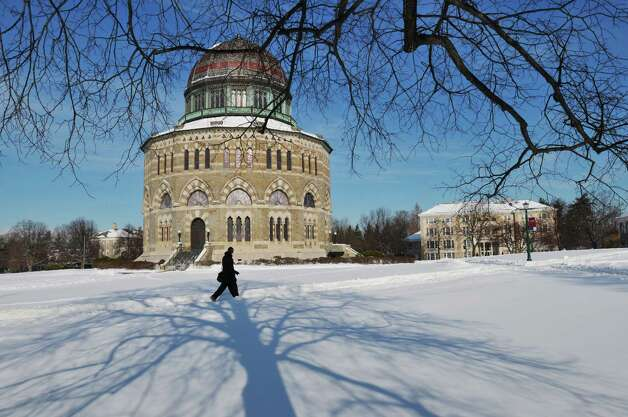 A student makes his way across the campus at Union College with the Nott Memorial seen in the background, on Sunday, Jan. 5, 2014 in Schenectady, NY.  Sunday was the first day the doors were open for students to return from  time off for Thanksgiving and Christmas.  (Paul Buckowski / Times Union) Photo: Paul Buckowski, Albany Times Union / 00025240A