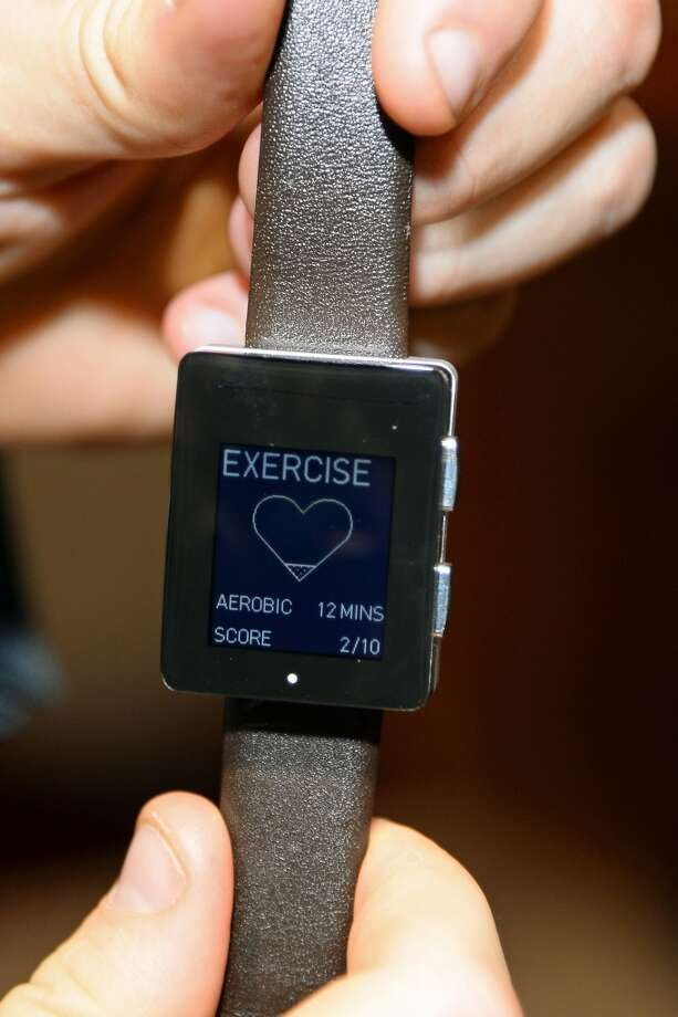 A Wellograph watch and activity tracker is displayed at a press event at the Mandalay Bay Convention Center for the 2014 International CES. Photo: Ethan Miller, Getty Images