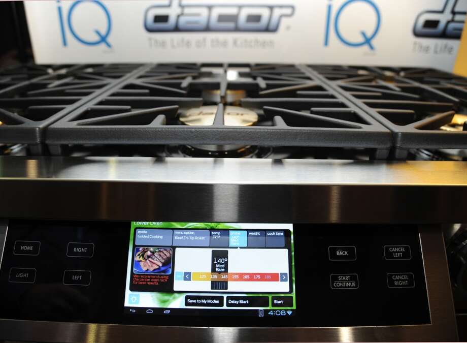 "The Discovery iQ 48 Dual-Fuel Range with a 7-inch Android 4.0 tablet built into the front panel from appliance maker Dacor is displayed at  ""CES: Unveiled,"" the media preview for International CES. Photo: ROBYN BECK, AFP/Getty Images"