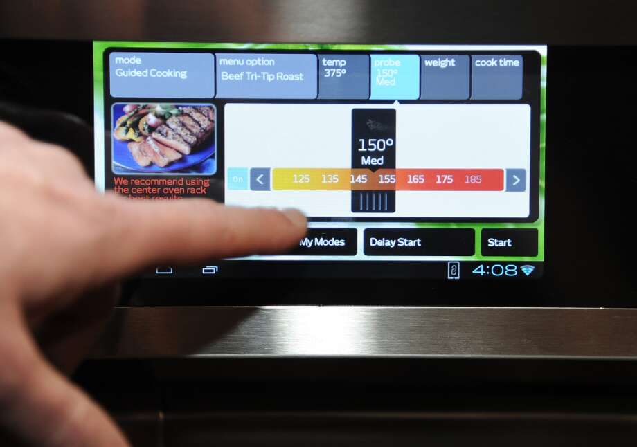 "The cooking temperature is set on an Android 4.0 tablet built into the front panel of the Discovery iQ 48 Dual-Fuel Range from appliance maker Dacor at  ""CES: Unveiled,"" the media preview for International CES. Photo: ROBYN BECK, AFP/Getty Images"