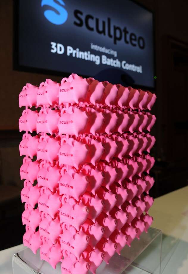 "Pink plastic pigs created with the Sculpteo 3D printing cloud engine are displayed at ""CES: Unveiled."" Photo: ROBYN BECK, AFP/Getty Images"