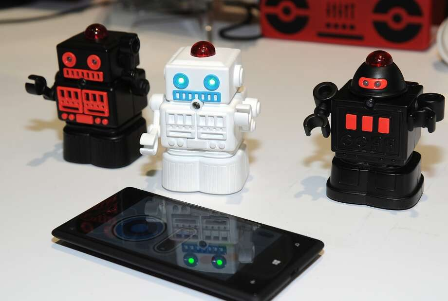 "Bluetooth Fighting Mini Robots by European company BeeWi are displayed at ""CES: Unveiled."" Photo: ROBYN BECK, AFP/Getty Images"