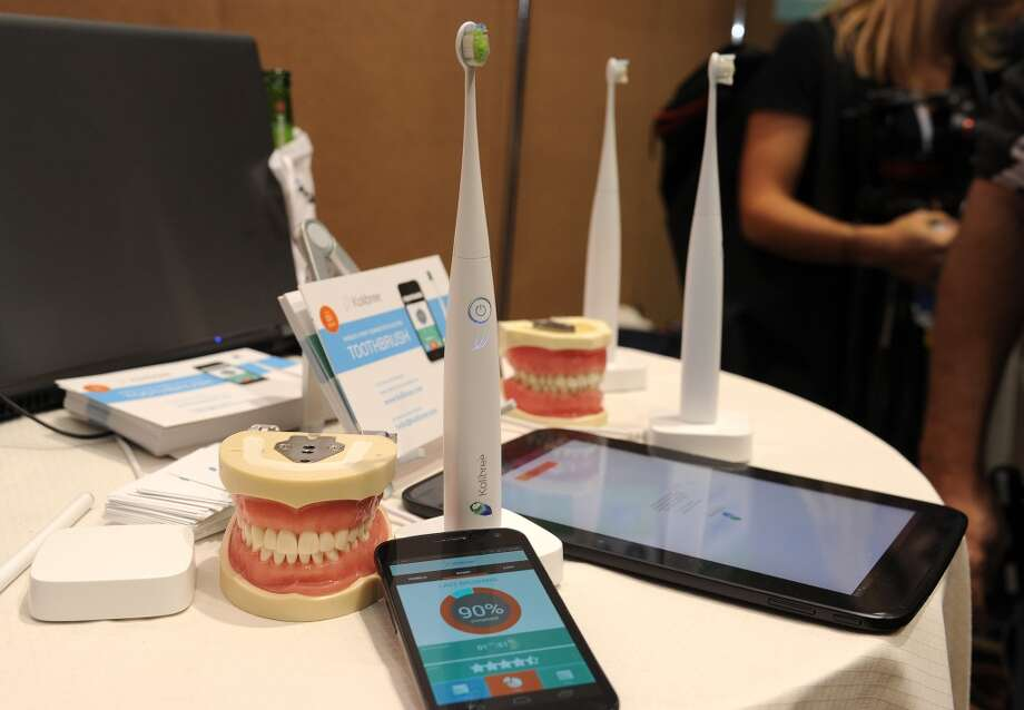 """The Kolibree toothbrush, the world's first Internet-connected toothbrush, is displayed at the """"CES: Unveiled."""" Photo: ROBYN BECK, AFP/Getty Images"""
