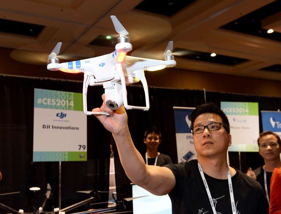 DJI Innovations product manager Paul Pan demonstrates the company's DJI Phantom 2 Vision aerial system during a CES press event. Photo: Ethan Miller, Getty Images