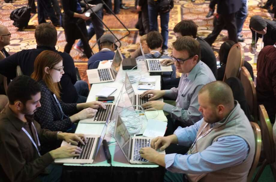 Journalists make their reports from the first press event 'CES Unveiled' at the Mandalay Bay Convention Center. Photo: JOE KLAMAR, AFP/Getty Images