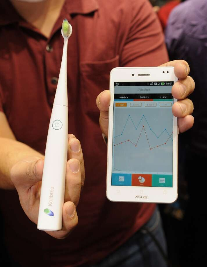 "The Kolibree toothbrush, the world's first Internet-connected toothbrush, is displayed ""CES: Unveiled."" Photo: ROBYN BECK, AFP/Getty Images"