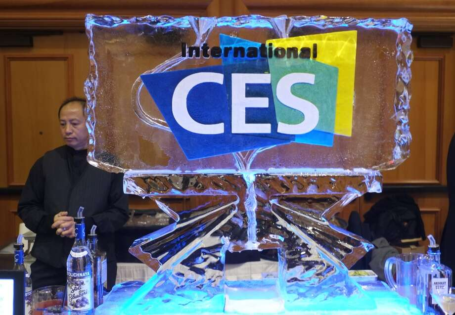 A bartender serves drinks during the first press event 'CES Unveiled' at the Mandalay Bay Convention Center prior to the 2014 International CES in Las Vegas. Photo: JOE KLAMAR, AFP/Getty Images