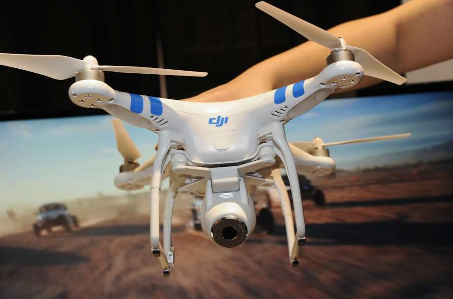 "A DJI Innovations DJI Phantom 2 Vision aerial system drone is shown during ""CES: Unveiled,"" the media preview for International CES. Photo: ROBYN BECK, AFP/Getty Images"