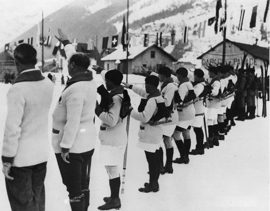 French athletes swear that they will conduct the Winter Olympic Games in a loyal way at the opening of the first Winter Olympics in Chamonix, France, on Jan. 25, 1924. Photo: Topical Press Agency, Getty Images / Hulton Archive