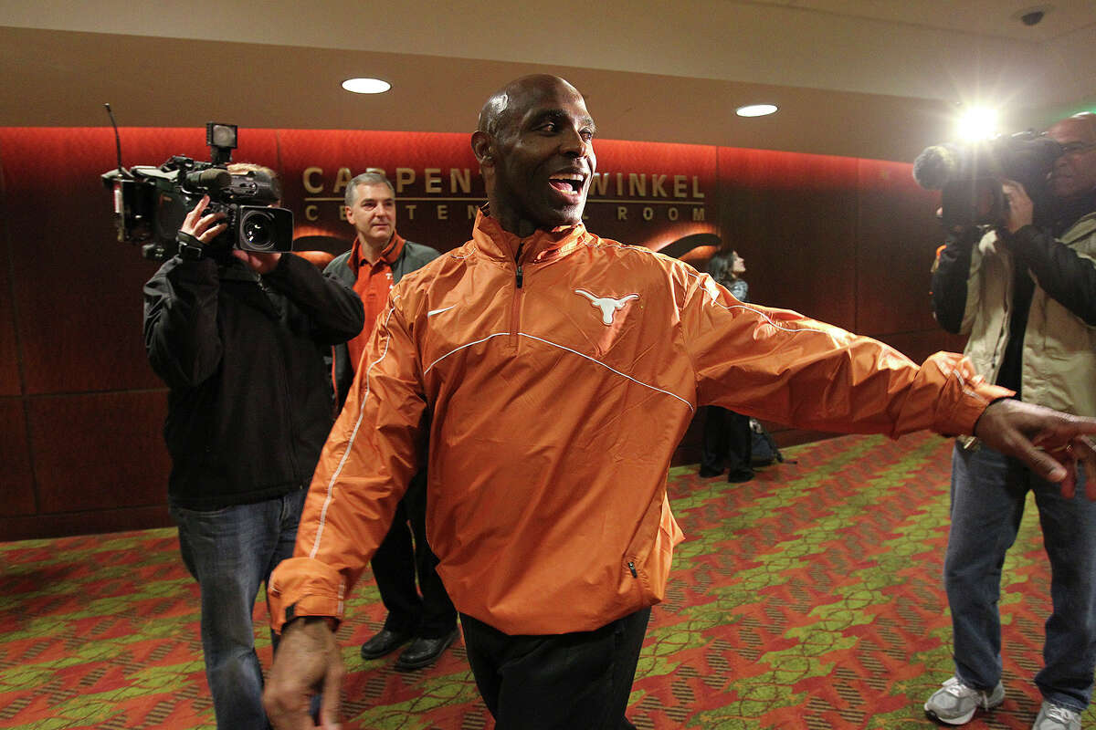 University of Texas Head Football Coach Charlie Strong leaves a staff meeting before a press conference at the campus in Austin, Monday, Jan. 6, 2014. Strong, 53, formerly Louisville coach, took the job Sunday night replacing Mack Brown.