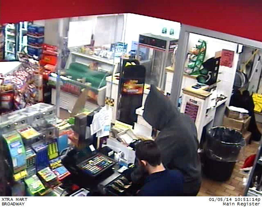 Colonie police released these images from surveillance video taken of an armed robbery at the Sunoco gas station at 616 Broadway near the Menands border on Sunday, Jan. 5, 2014. Photo: Colonie Police