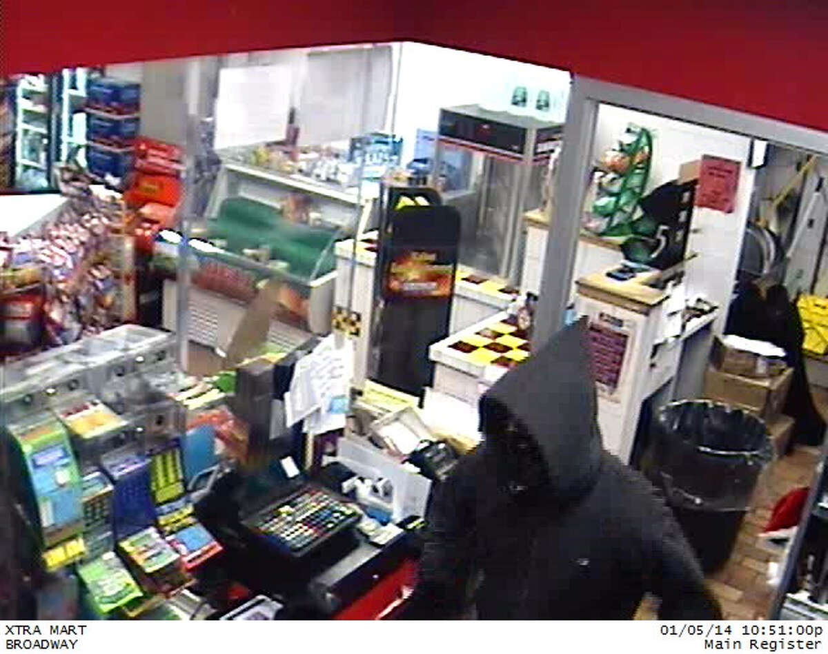 Colonie police released these images from surveillance video taken of an armed robbery at the Sunoco gas station at 616 Broadway near the Menands border on Sunday, Jan. 5, 2014.