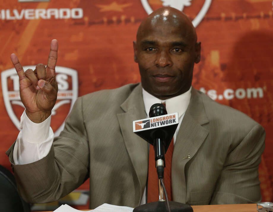 University of Texas Head Football Coach Charlie Strong flashes the hook 'em horns sign to end a press conference at the campus in Austin, Monday, Jan. 6, 2014. Strong, 53, formerly University of Louisville coach, took the job Sunday night replacing Mack Brown. Photo: Jerry Lara, San Antonio Express-News / ©2013 San Antonio Express-News