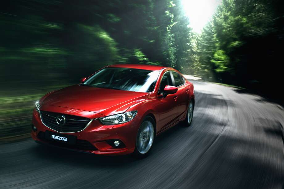 "Popular Mechanics anointed the 2014 Mazda6 (shown) its ""ar of the Year,"" lauded the sedan's technology."