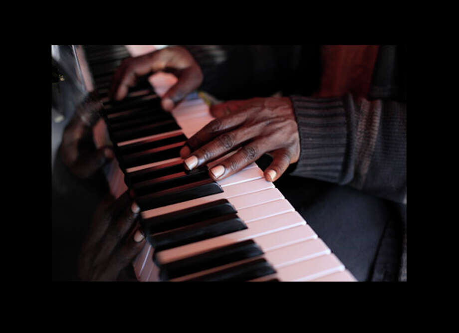 Walter Earl says he can't imagine a day not playing the piano. Photo: Mike Kepka, The Chronicle / ONLINE_YES