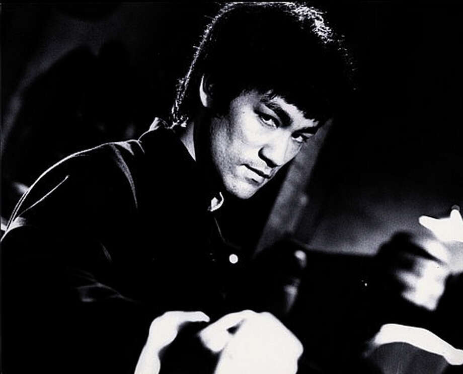 "Bruce Lee is a man seeking revenge for the death of his mentor in ""The Chinese Connection."""