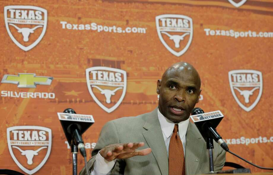 Charlie Strong answers questions during a news conference where he was introduce as the new Texas football coach, Monday,  Jan. 6, 2014, in Austin, Texas. (AP Photo/Eric Gay) Photo: Eric Gay, Associated Press / AP