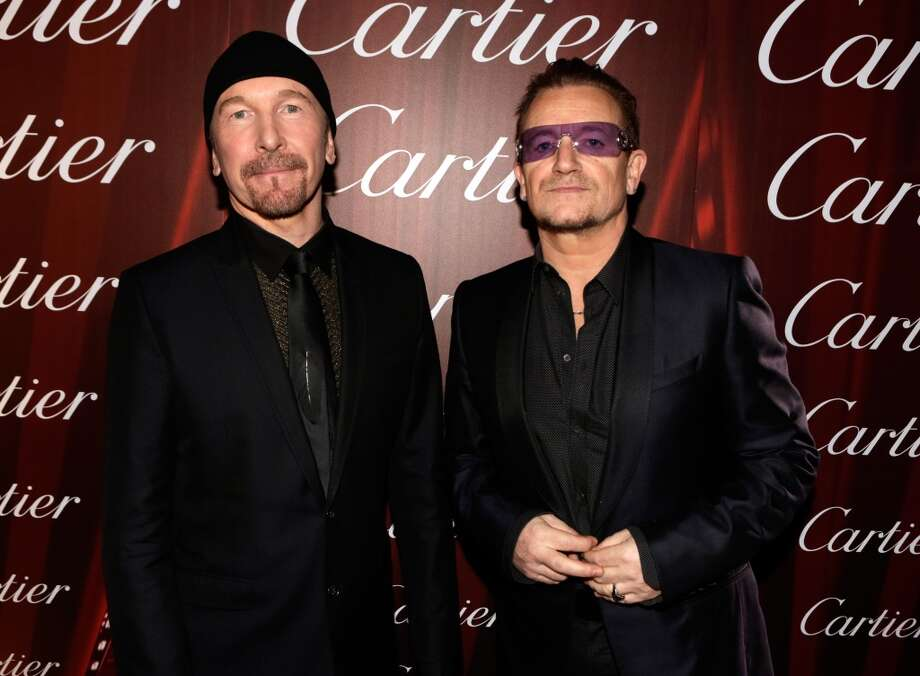 Musicians The Edge (L) and Bono of U2 arrive at the 25th annual Palm Springs International Film Festival awards gala at Palm Springs Convention Center on January 4, 2014 in Palm Springs, California.  (Photo by Jeff Vespa/Getty Images for PSIFF) Photo: Jeff Vespa, Getty Images For PSIFF