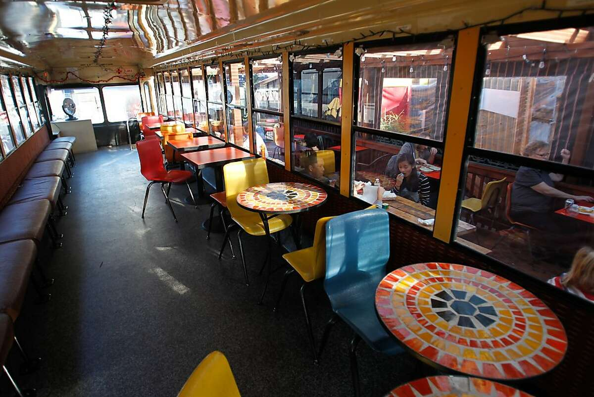 A converted school bus offers diners a funky place to eat inside at the Soma Streatfood Park on Sunday, Dec. 29, 2013.
