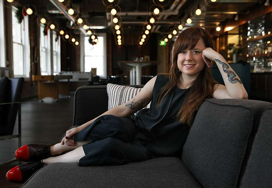 Designer Lauren Geremia stretches out in the dining room at Lumosity in S.F. Photo: Liz Hafalia, The Chronicle