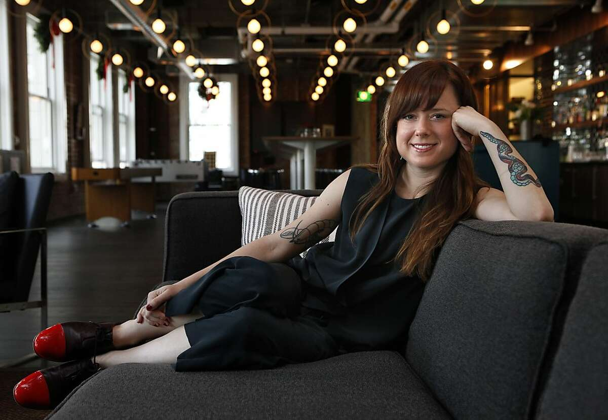 Designer Lauren Geremia shows the dining room at Luminosity in San Francisco, Calif., on Tuesday, December 17, 2013.