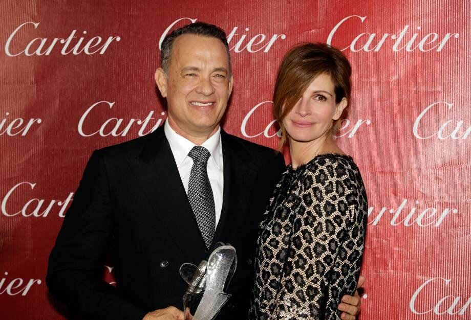 Honoree Tom Hanks (L) and presenter Julia Roberts pose with the Chairman's Award backstage during the 25th annual Palm Springs International Film Festival awards gala at Palm Springs Convention Center on January 4, 2014 in Palm Springs, California.  (Photo by Jeff Vespa/Getty Images for PSIFF) Photo: Jeff Vespa, Getty Images For PSIFF