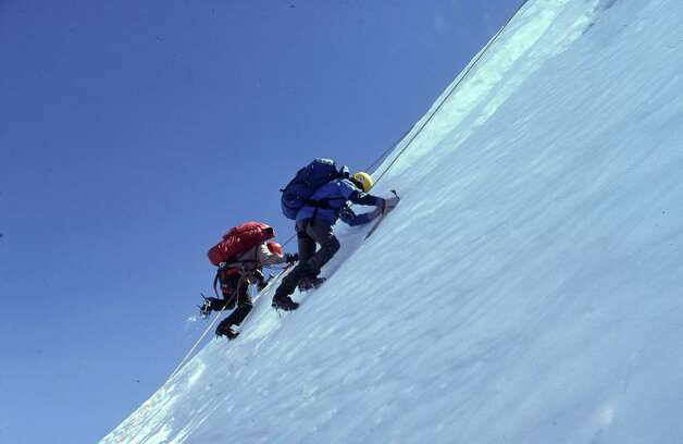 Tom Smyth and Jonathan Calvert attack the steep-angled pitch Calvert named the Ramp on Kilimanjaro in 1979. Calvert's final climb was the Greenland ice cap in 2007. Photo: Photos Courtesy Jonathan Calvert / Pentagram