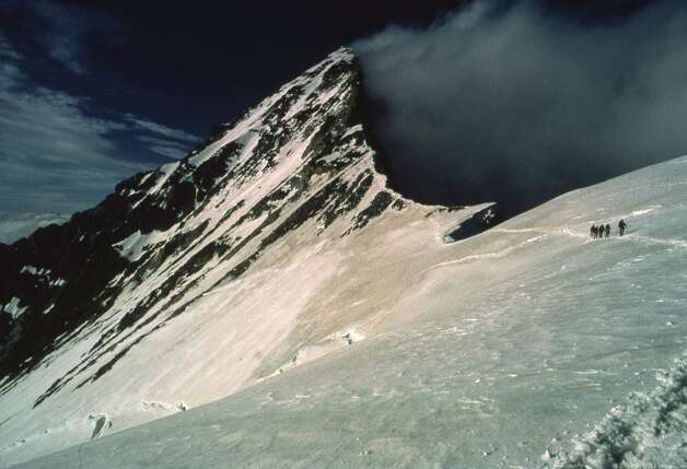 This 1980 descent of the south ridge of Switzerland's Dent Blanche, close to sundown, came after experiencing blowing snow near the summit.