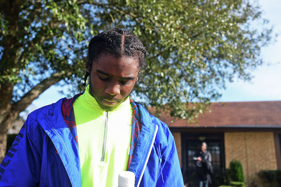 Ozen Panthers football player Tony Brown stands outside of his place of residence after visiting with the University of Texas head football coach Mack Brown on Thursday.  Michael Rivera/@michaelrivera88  Photo taken Dec. 12, 2013.