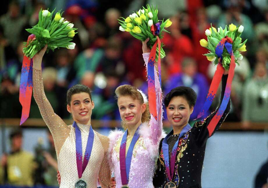 Kerrigan takes the medal stand with gold medal winner Oksana Balul of the Ukraine and Lu Chen of China on Feb. 25, 1994. Photo: Mike Powell, Getty Images / Getty Images Europe