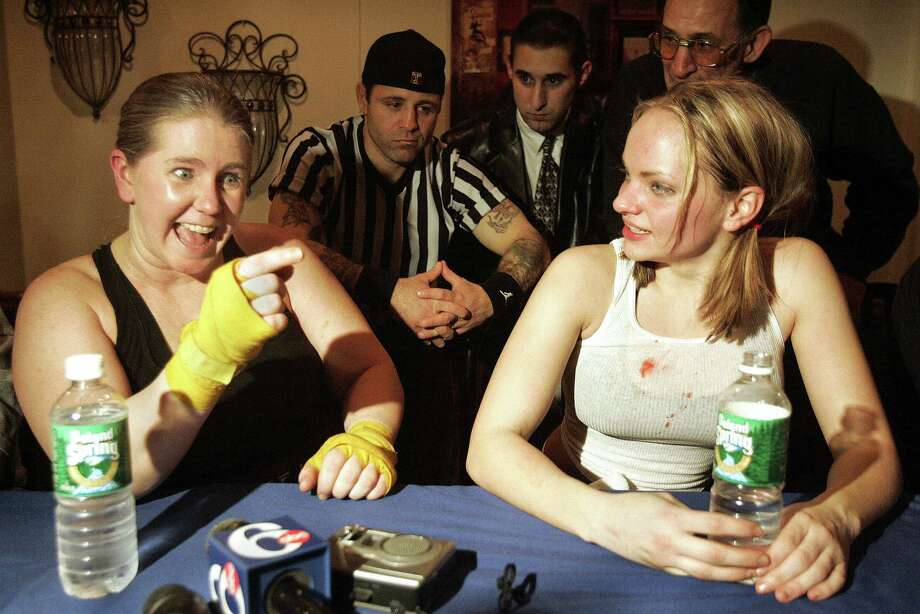 Afterward, the two boxers talked to reporters. Photo: Boston Globe, Getty Images / 2011 - The Boston Globe