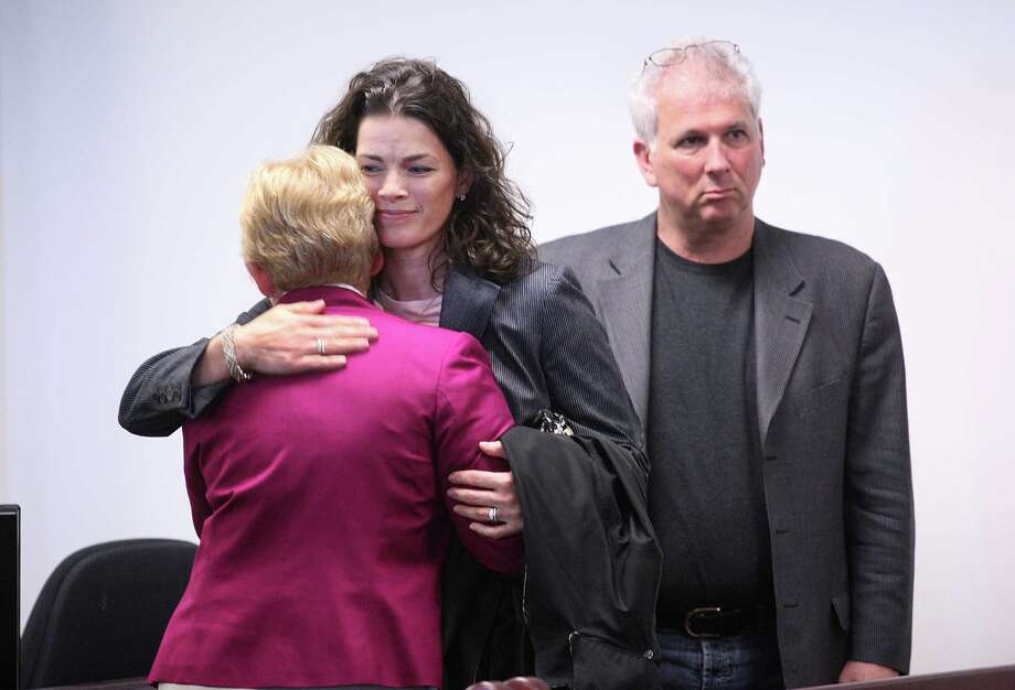 Her brother was tried and acquitted in her father's death. He was convicted of assault and battery. Here Kerrigan hugs her mother as she attends her brother's trial with her husband.  Photo: Boston Globe, Getty Images / 2011 - The Boston Globe