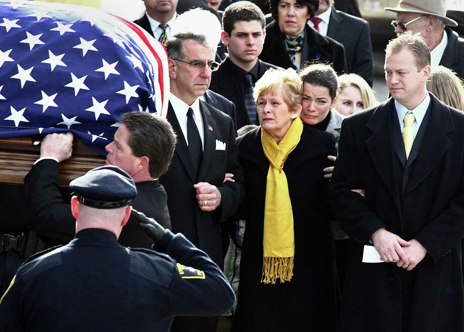 Her life has not been without tragedy. Her father died after a struggle with her brother. Here she embraces her mother, Brenda Kerrigan, as her father's casket is carried into the church on Jan. 28, 2010. Photo: Boston Globe, Getty Images / 2011 - The Boston Globe