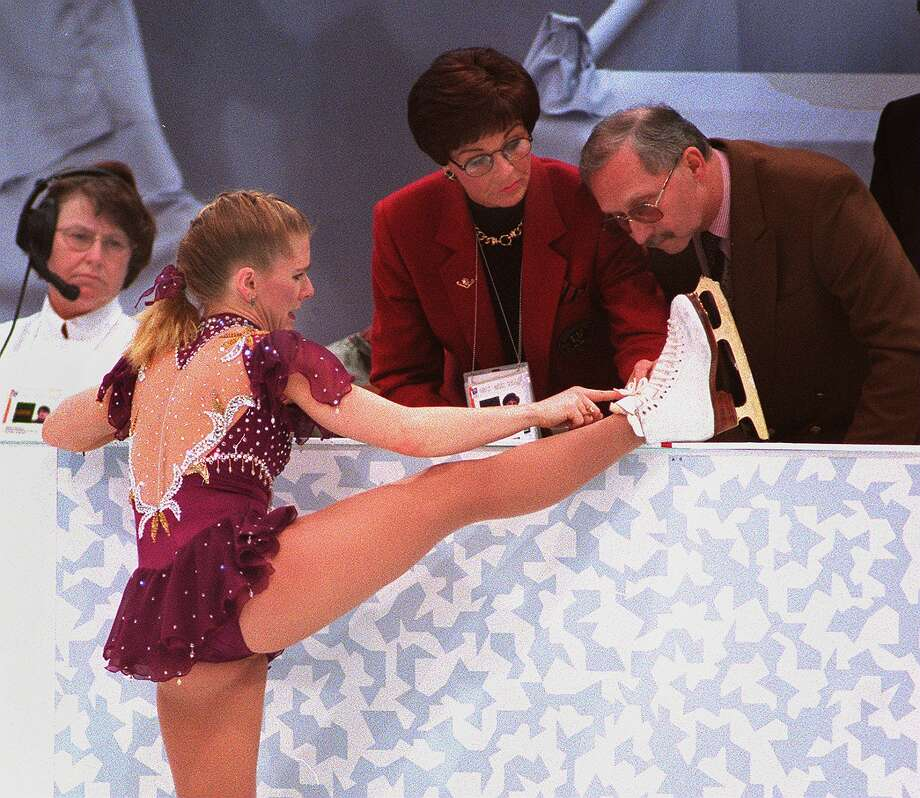 For Harding, her Olympics will be remembered for a broken shoelace on Feb. 25, 1994. Here a judge examines it.  Photo: Boston Globe, Getty Images / 2013 - The Boston Globe - The Boston Globe