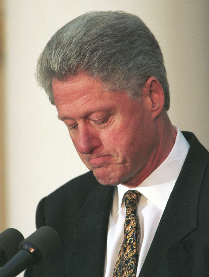 President Clinton pauses as he apologized to the country December 11, 1998 for his conduct in the Monica Lewinsky affair and said he would accept a congressional censure or rebuke. ``I am ready to accept that,'''' he said in a dramatic Rose Garden statement as a bitterly divided House Judiciary Committee debated four articles of impeachment. Today's remarks marked the first time he has expressed willingness to be censured. ``I understand that accountability demands consequences and I am prepared to accept them,''' he said. Photo: Richard Ellis, Getty Images / Hulton Archive
