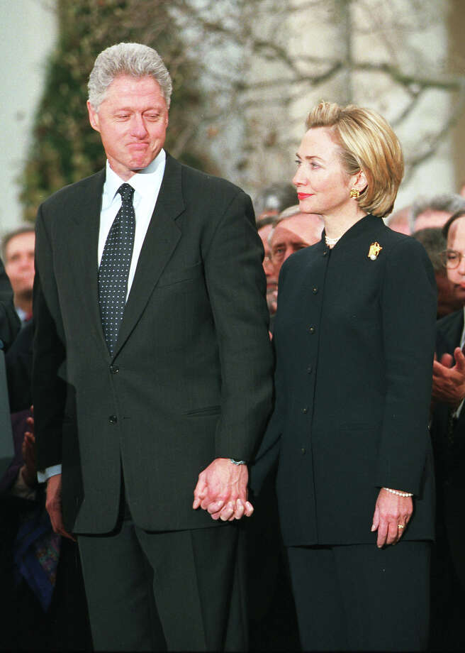 "Tuesday, January 7, 2014 is the 15th anniversary of the start of the impeachment proceedings against President Bill Clinton. Here's a look back at the craziness:President Bill Clinton looks toward wife Hillary before addressing the American people following a vote for his impeachment December 19, 1998 at the White House. Clinton ignored calls for his resignation in the face of impeachment , vowing to remain in office ""until the last hour of my last day of my term."" Photo: Richard Ellis, Getty Images / Hulton Archive"