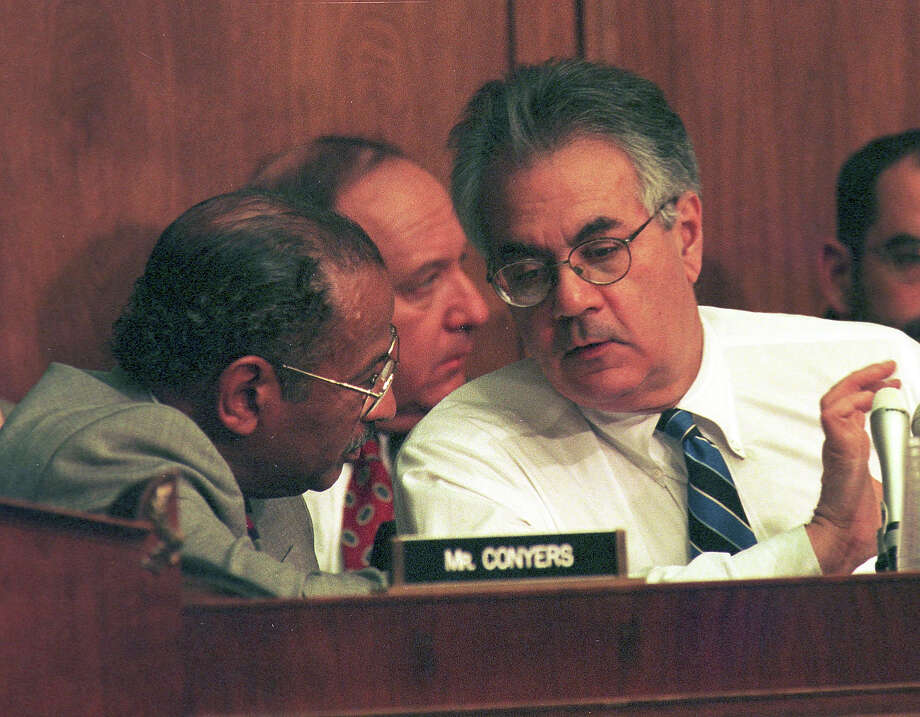 Ranking democratic member of the House Judiciary committee Rep. John Conyers (L) talks with senior member Rep. Barney Frank during hearings on whether impeachment proceedings should begin against President Bill Clinton October 5, 1998 in Washington, DC. This is only the third time in US history that impeachment proceedings against a President have been brought to the House committee. Photo: Richard Ellis, Getty Images / Hulton Archive