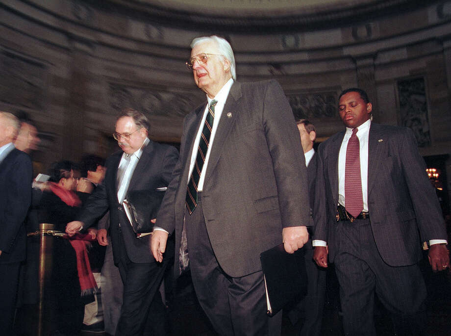 Rep. Henry Hyde, chairman of the House Managers on Impeachment walks through the Capitol rotunda to the Senate chambers January 7, 1999 to open the impeachment trial against President Bill Clinton. Photo: Richard Ellis, Getty Images / Hulton Archive