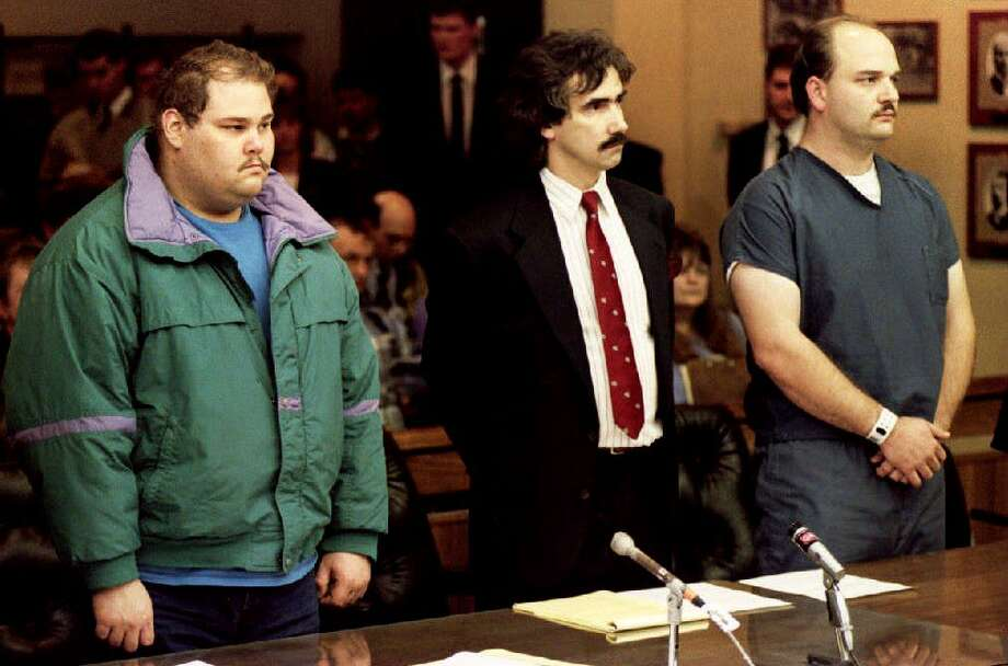 Shawn Eric Eckardt (L), bodyguard of figure skater Tonya Harding, and fellow defendent Derrick Smith (R) are joined by Smith's attorney Robert Goffredi on Jan. 14, 1994, as they face Judge Donald Londer during their arraignment on charges of conspiracy to commit assault in the attack on skater Nancy Kerrigan.  Photo: CHRIS WILKINS, Getty Images / AFP