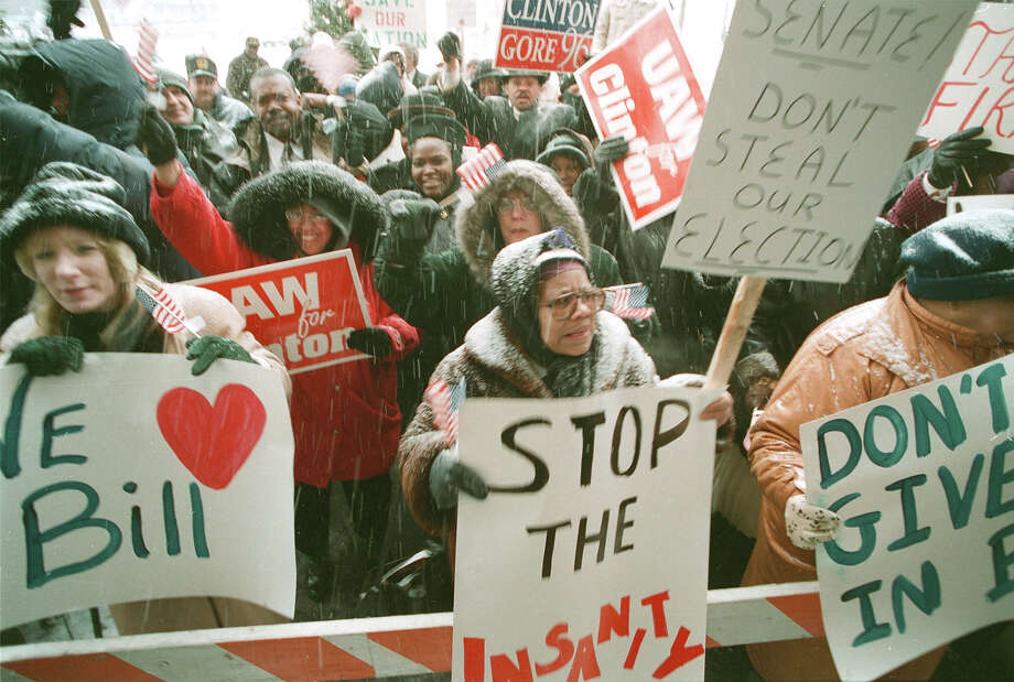 About 200 supporters of President Bill Clinton, many of them auto and steel workers, stood in a snowstorm in Detroit outside the North American International Auto Show while Clinton toured the exhibits and spoke to the Detroit Economic Club. Photo: George Waldman, Getty Images / Hulton Archive