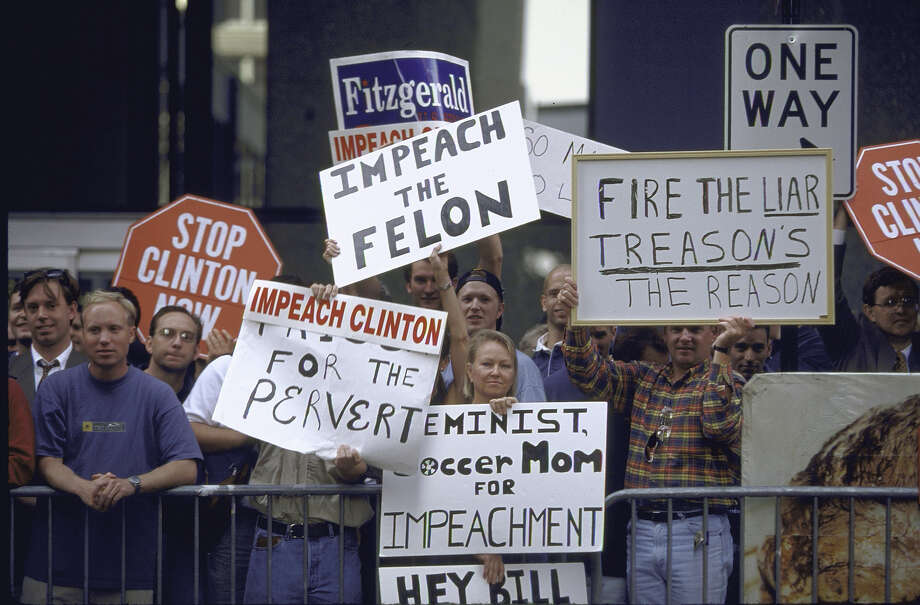 Protestors waving signs calling for Pres. Bill Clinton's impeachment re his affair w. White House intern Monica Lewinsky. Photo: Diana Walker, Time & Life Pictures/Getty Image / Diana Walker