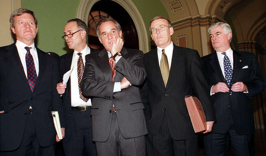 Democratic Congressmen (from L-R) Max Baucus, (D-MT), Charles Schumer, (D-NY), Robert Torricelli, (D-NJ), Byron Dorgan, (D-ND) and Christopher Dodd, (D-CT), wait to speak to reporters outside the Senate chambers following a vote to depose witnesses for US President Bill Clinton's impeachment trial on Capitol Hill in Washington DC, 27 January. The Senate also rejected a motion to dismiss the case in addition to calling for witnesses by a vote of 56-44. Photo: STEPHEN JAFFE, AFP/Getty Images / AFP